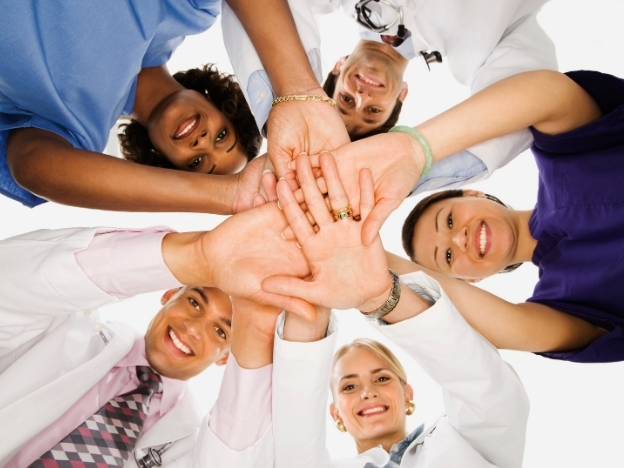 Group of healthcare workers together with hands